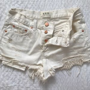 FREE PEOPLE distressed cream denim shorts